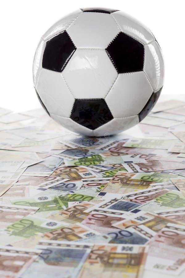 Χρήματα και ποδόσφαιρο στοκ εικόνες