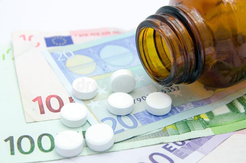 Χρήματα και χάπια στοκ φωτογραφίες με δικαίωμα ελεύθερης χρήσης