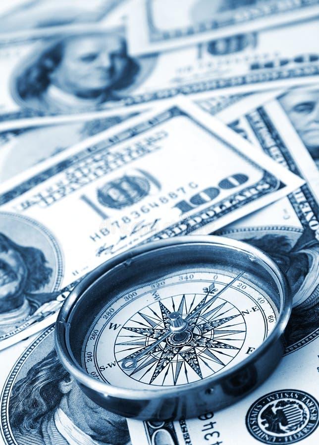χρήματα πυξίδων στοκ φωτογραφία
