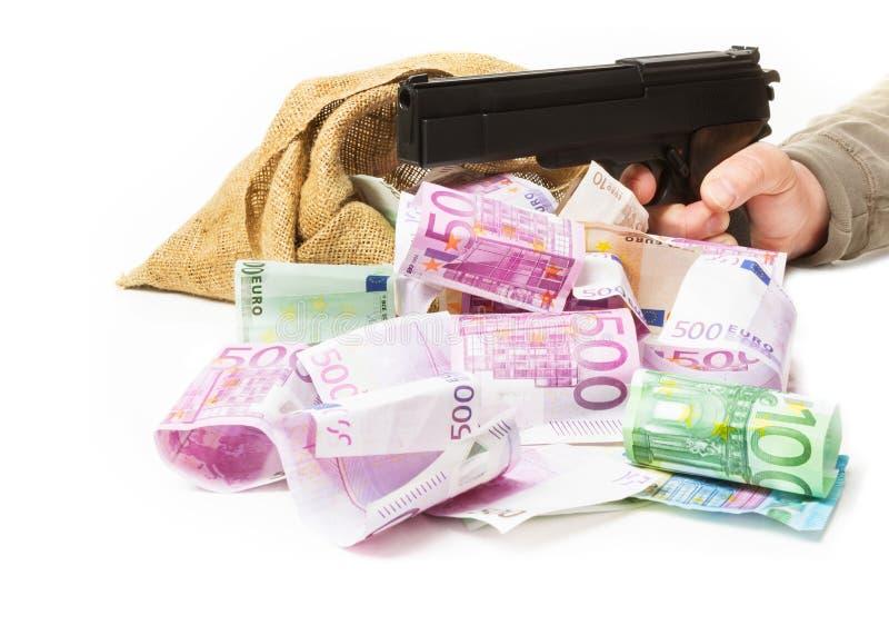 Χρήματα, πυροβόλο όπλο, επιδρομή τραπεζών στοκ φωτογραφία