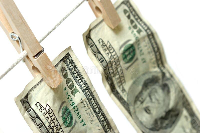 χρήματα σκοινιών για άπλωμ&alph στοκ φωτογραφίες