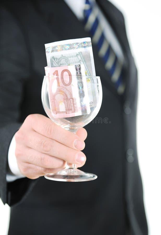 Χρήματα στα glas στοκ εικόνες