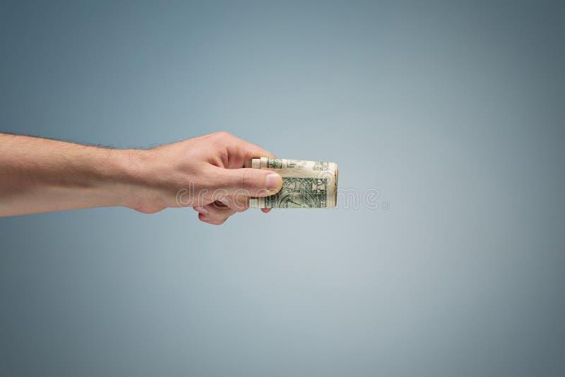 Χρήματα στο χέρι στοκ φωτογραφία