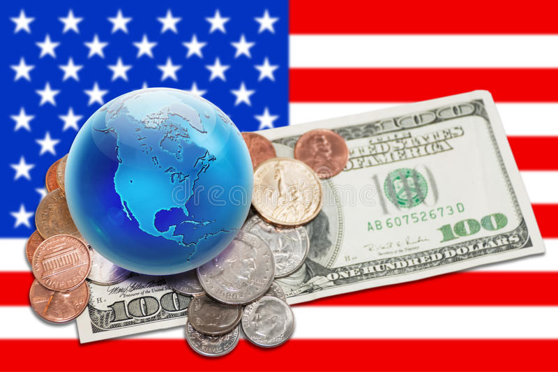 χρήματα σφαιρών νομίσματος εμβλημάτων πέρα από τον αμερικανικό κόσμο στοκ εικόνα