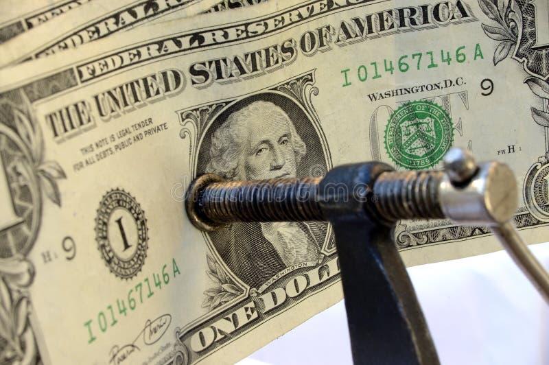 χρήματα σφιχτά στοκ φωτογραφία