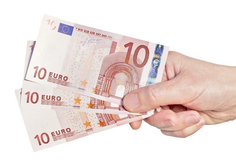 χρήματα χεριών ευρώ στοκ εικόνα