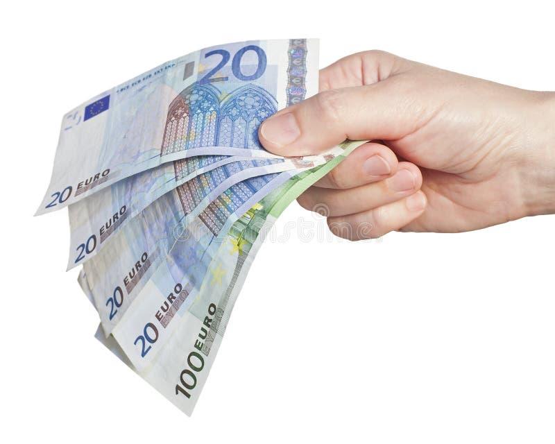 χρήματα χεριών ευρώ στοκ εικόνες