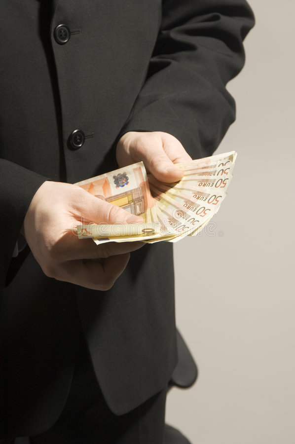 χρήματα χεριών στοκ φωτογραφία με δικαίωμα ελεύθερης χρήσης