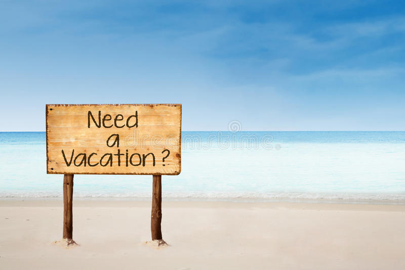 Χρειαστείτε ένα σημάδι διακοπών στην παραλία στοκ εικόνες