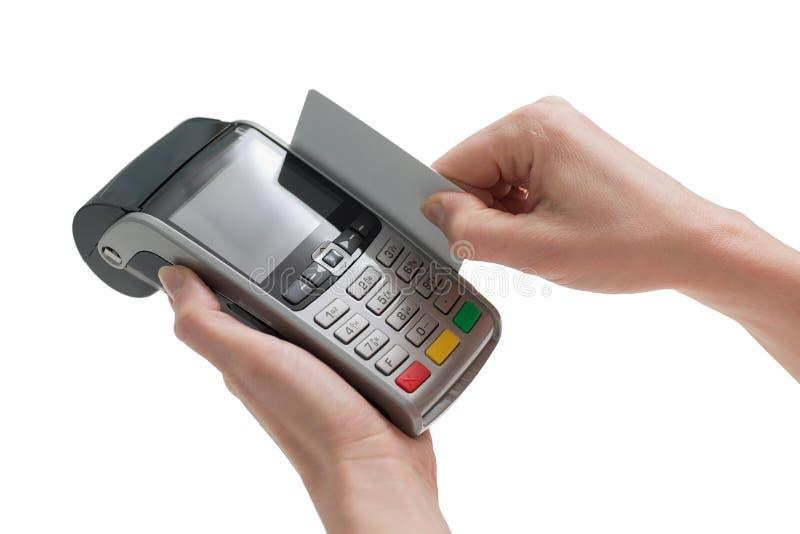 Χρεωστικών καρτών μέσω pos του τερματικού στοκ εικόνα