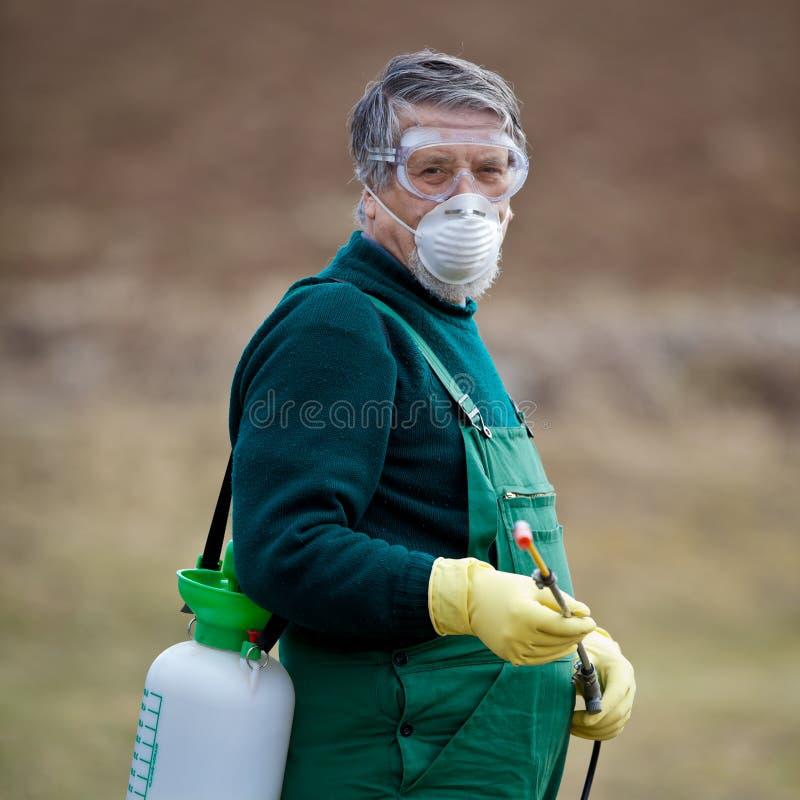 χρησιμοποίηση οπωρώνων κήπων χημικών ουσιών στοκ φωτογραφίες
