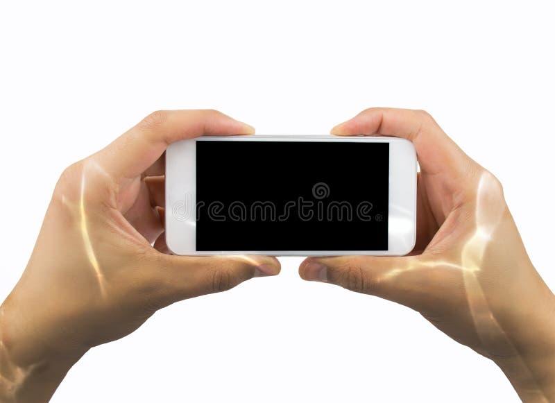 Χρησιμοποίηση του νέου αδιάβροχου smartphone μου στοκ φωτογραφίες