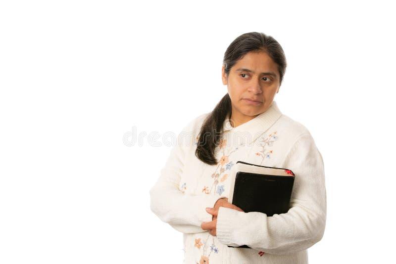 Χριστιανική Βίβλος εκμετάλλευσης γυναικών που απομονώνεται στο άσπρο υπόβαθρο στοκ εικόνες