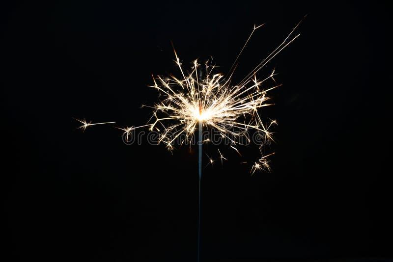 Χριστούγεννα καψίματος sparkler στοκ εικόνες με δικαίωμα ελεύθερης χρήσης
