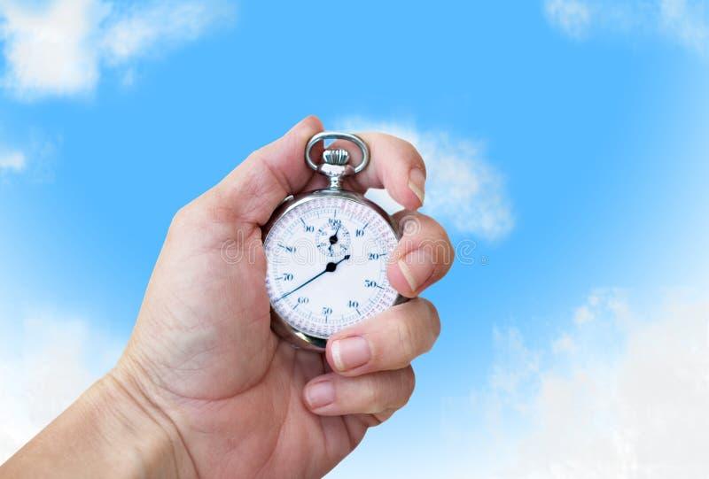 χρονόμετρο με διακόπτη παραγωγής εκμετάλλευσης χεριών στοκ φωτογραφίες με δικαίωμα ελεύθερης χρήσης