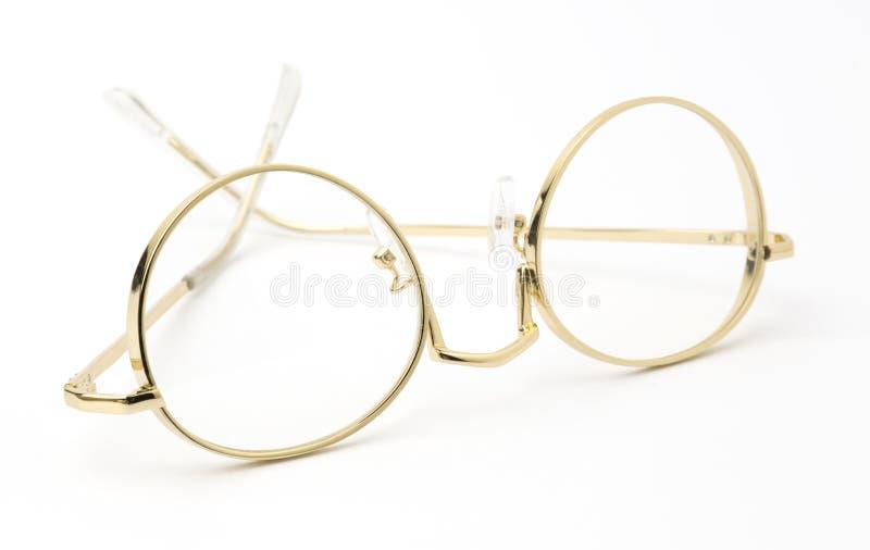 Χρυσά γυαλιά ματιών που διπλώνονται που απομονώνονται στο λευκό στοκ εικόνα