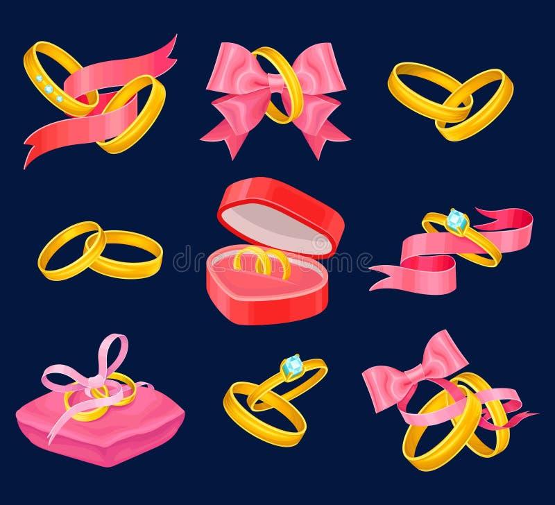 Χρυσά δαχτυλίδια γάμου και δέσμευσης καθορισμένα Τα απομονωμένα αντικείμενα με τις ρόδινες κορδέλλες, καρδιά διαμόρφωσαν το κιβώτ ελεύθερη απεικόνιση δικαιώματος
