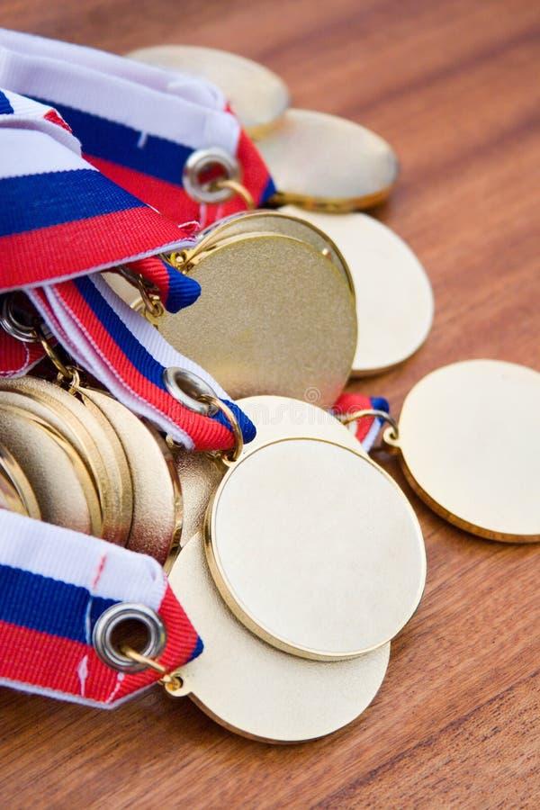 χρυσά μετάλλια στοκ εικόνες με δικαίωμα ελεύθερης χρήσης
