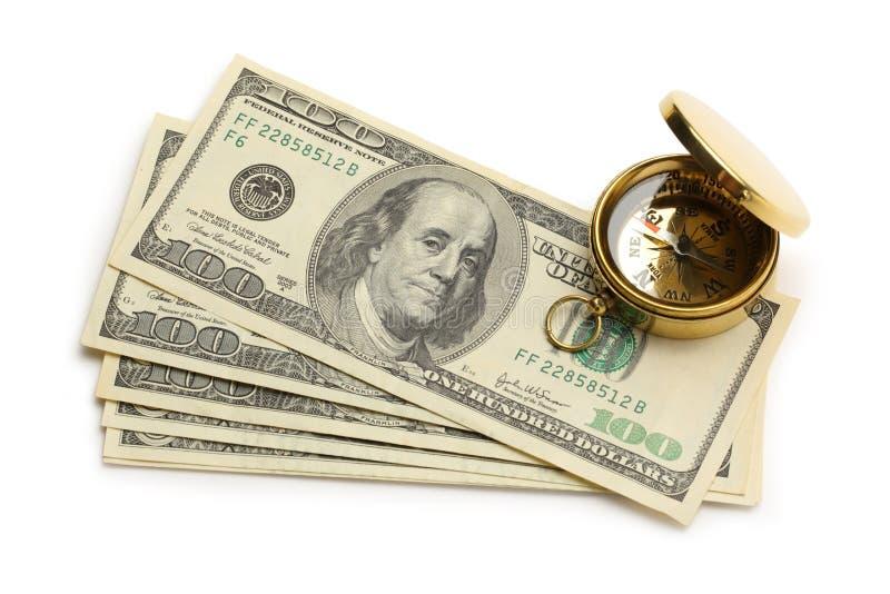 Χρυσά πυξίδα και δολάρια στοκ εικόνες