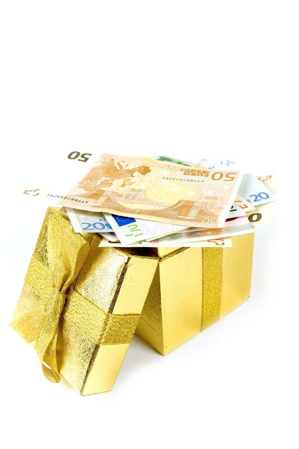 χρυσά χρήματα δώρων κιβωτίω&nu στοκ φωτογραφία με δικαίωμα ελεύθερης χρήσης