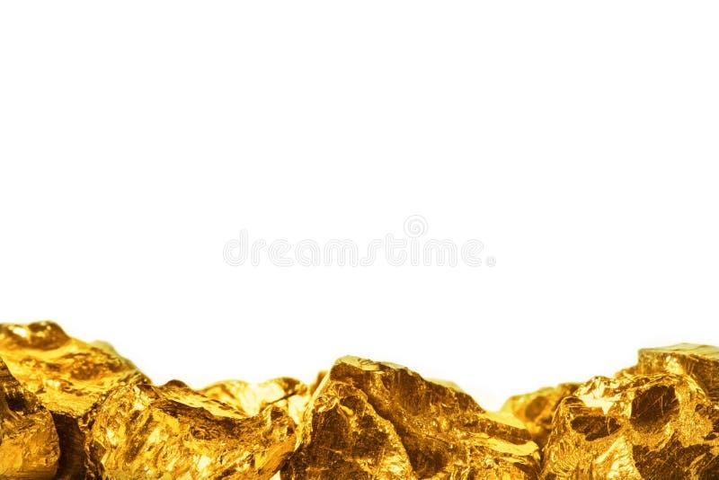 Χρυσά ψήγματα που απομονώνονται στο άσπρο υπόβαθρο στοκ εικόνες