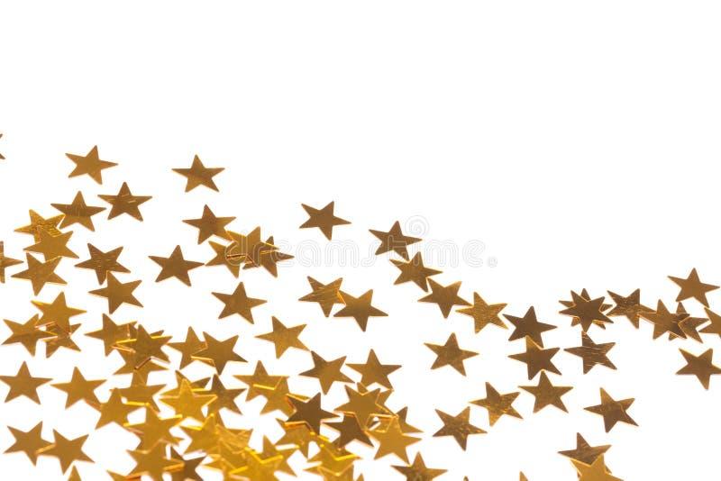 Χρυσές διακοσμήσεις αστεριών που διαδίδονται έξω στοκ εικόνα με δικαίωμα ελεύθερης χρήσης