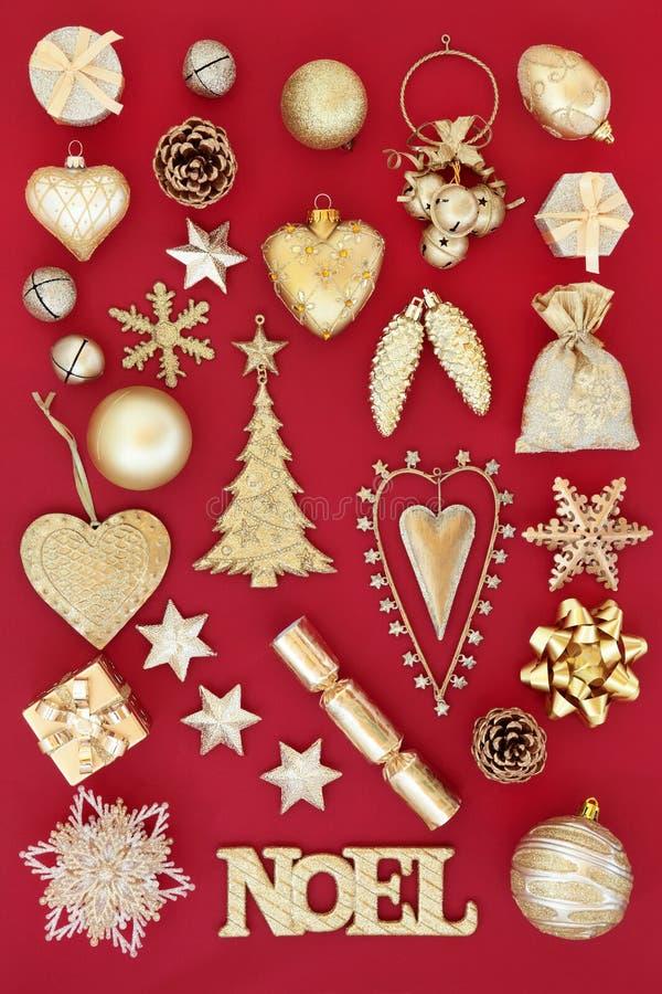 Χρυσές διακοσμήσεις Χριστουγέννων Noel στοκ εικόνες με δικαίωμα ελεύθερης χρήσης