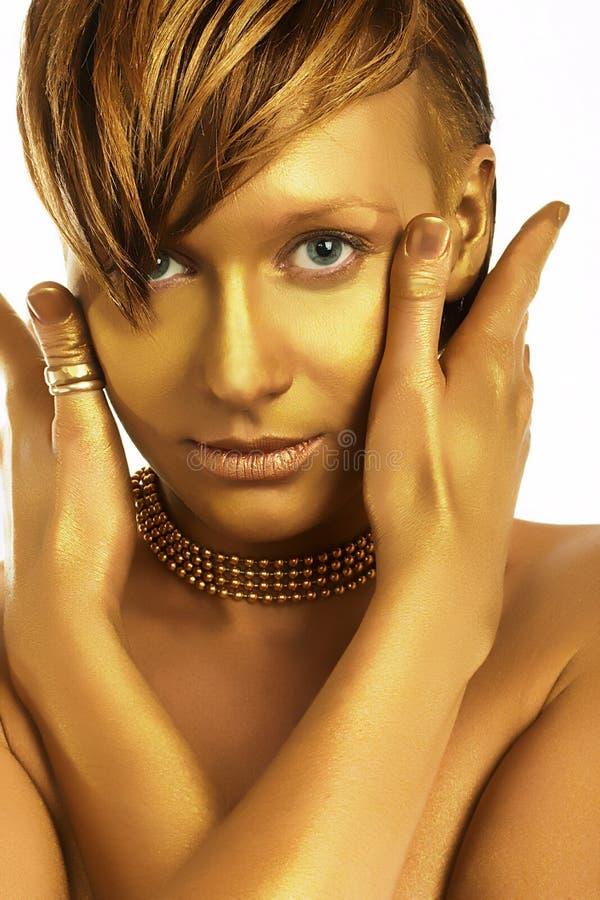 Download χρυσή γυναίκα στοκ εικόνα. εικόνα από ανασκόπησης, τρίχωμα - 384769