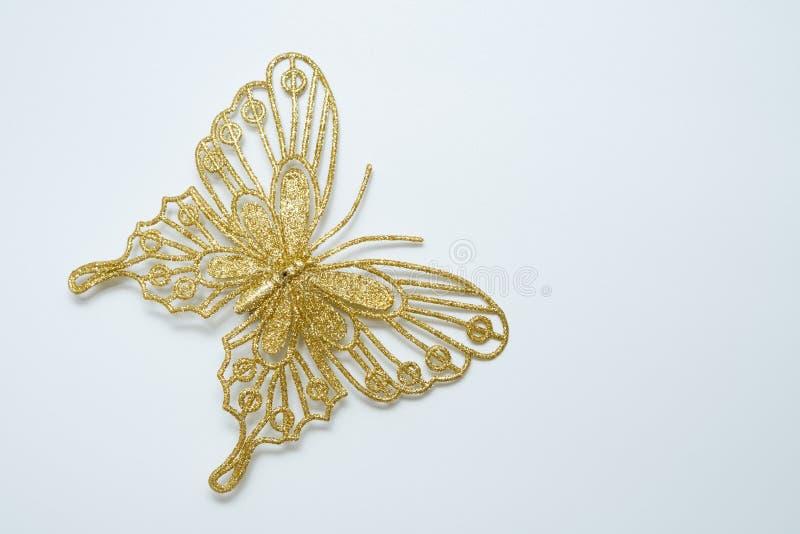 Χρυσή πεταλούδα Χριστουγέννων glittery στοκ εικόνες με δικαίωμα ελεύθερης χρήσης
