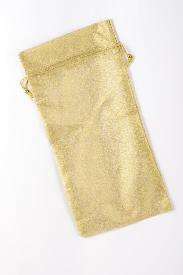 Χρυσή σακούλα δώρων στοκ φωτογραφία