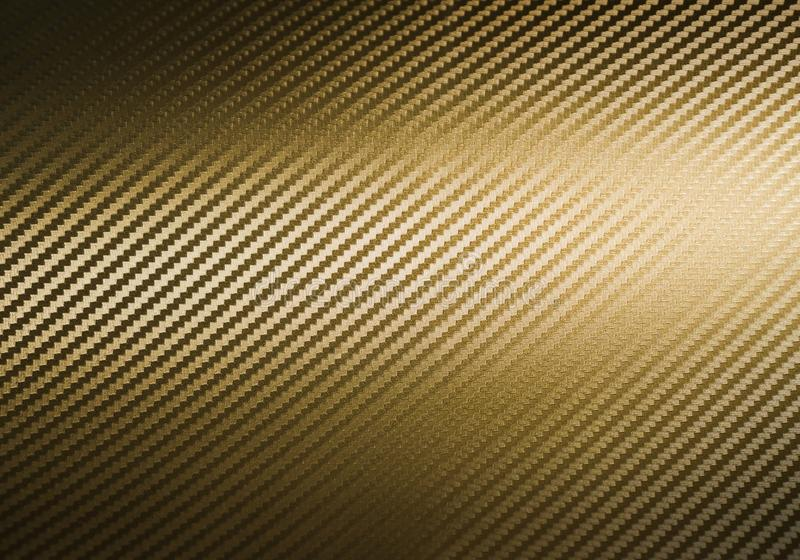 Χρυσή σύσταση ινών άνθρακα στοκ φωτογραφία με δικαίωμα ελεύθερης χρήσης