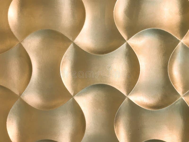 Χρυσή τρισδιάστατη εσωτερική διακοσμητική επιτροπή τοίχων με την ασυνήθιστη γεωμετρική μορφή στοκ εικόνες