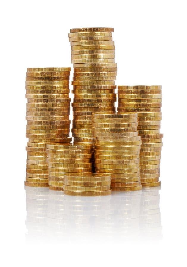 χρυσοί σωροί νομισμάτων στοκ εικόνες