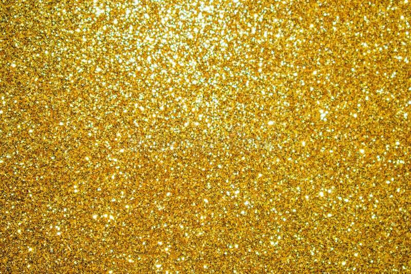 Χρυσός ακτινοβολήστε ζωηρόχρωμο αφηρημένο υπόβαθρο σύστασης στοκ εικόνα με δικαίωμα ελεύθερης χρήσης