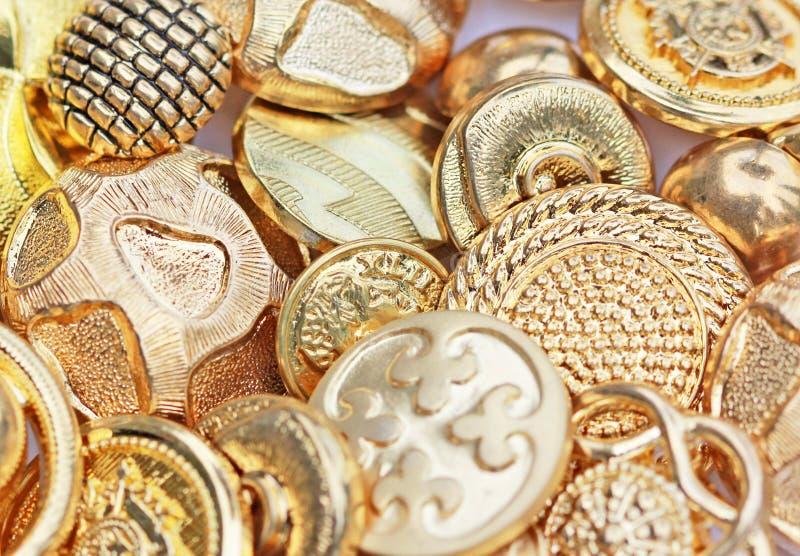 χρυσός κουμπιών στοκ φωτογραφία