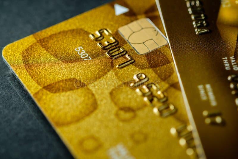 Χρυσός μακρο πυροβολισμός πιστωτικών καρτών στοκ εικόνα