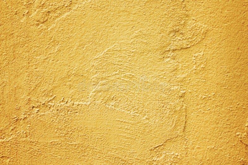 Χρυσός τοίχος τσιμέντου σύστασης στην τραχιά περίληψη σχεδίων για το υπόβαθρο στοκ εικόνες με δικαίωμα ελεύθερης χρήσης