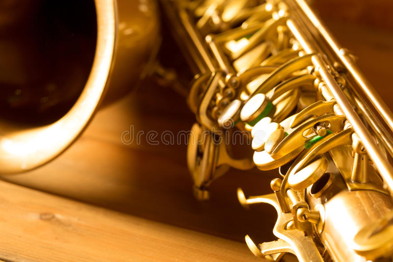 Χρυσός τρύγος saxophone γενικής ιδέας σκεπάρνι αναδρομικός στοκ εικόνα