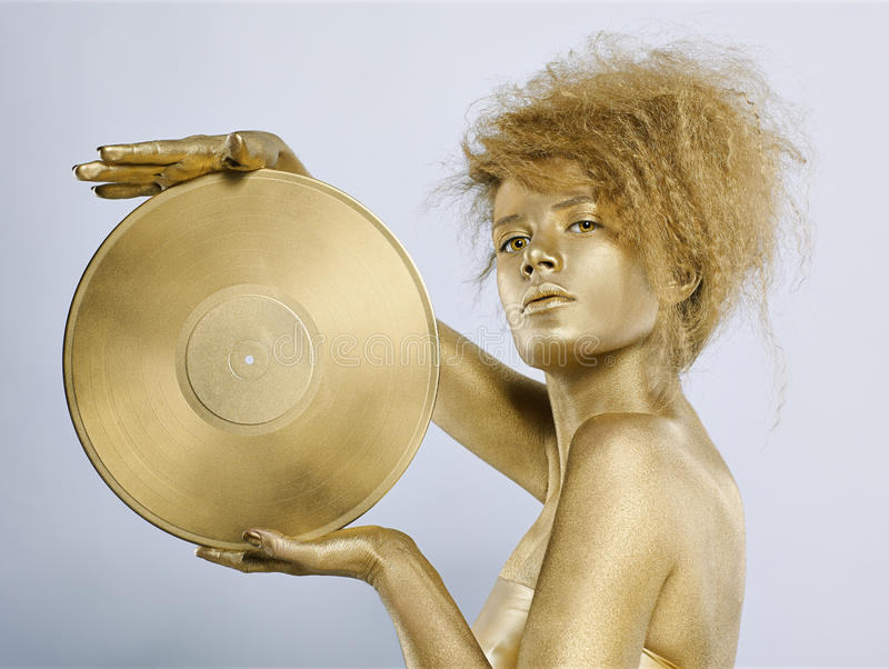 Download χρυσό βινύλιο κοριτσιών στοκ εικόνα. εικόνα από hairstyle - 17050205