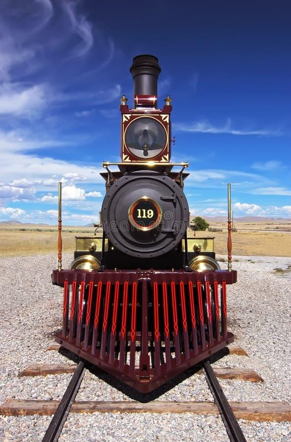 χρυσό ιστορικό τραίνο ακίδ& στοκ εικόνες