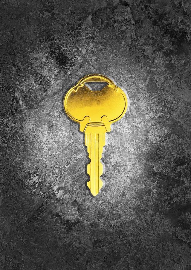 Χρυσό κλειδί στοκ φωτογραφία με δικαίωμα ελεύθερης χρήσης