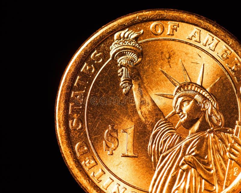 Χρυσό μέρος νομισμάτων δολαρίων στοκ εικόνες με δικαίωμα ελεύθερης χρήσης