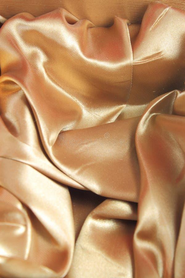 χρυσό μετάξι ανασκόπησης στοκ εικόνες