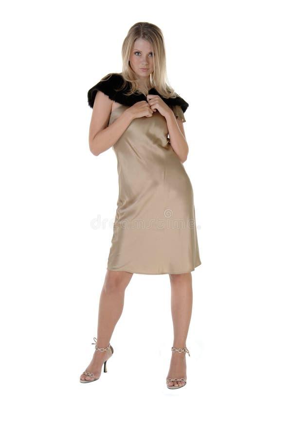 χρυσό μοντέλο μόδας στοκ εικόνα
