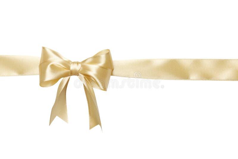 Χρυσό μπεζ τόξο κορδελλών χρώματος που απομονώνεται στο άσπρο υπόβαθρο στοκ φωτογραφία με δικαίωμα ελεύθερης χρήσης