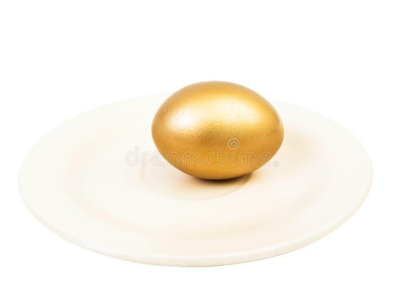 χρυσό πιάτο αυγών στοκ φωτογραφία με δικαίωμα ελεύθερης χρήσης