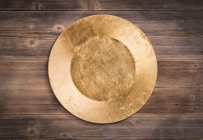Χρυσό πιάτο στοκ εικόνες