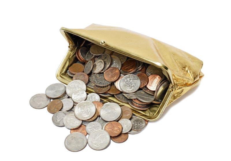 Χρυσό πορτοφόλι νομισμάτων που ανατρέπει τα νομίσματα στοκ εικόνα με δικαίωμα ελεύθερης χρήσης