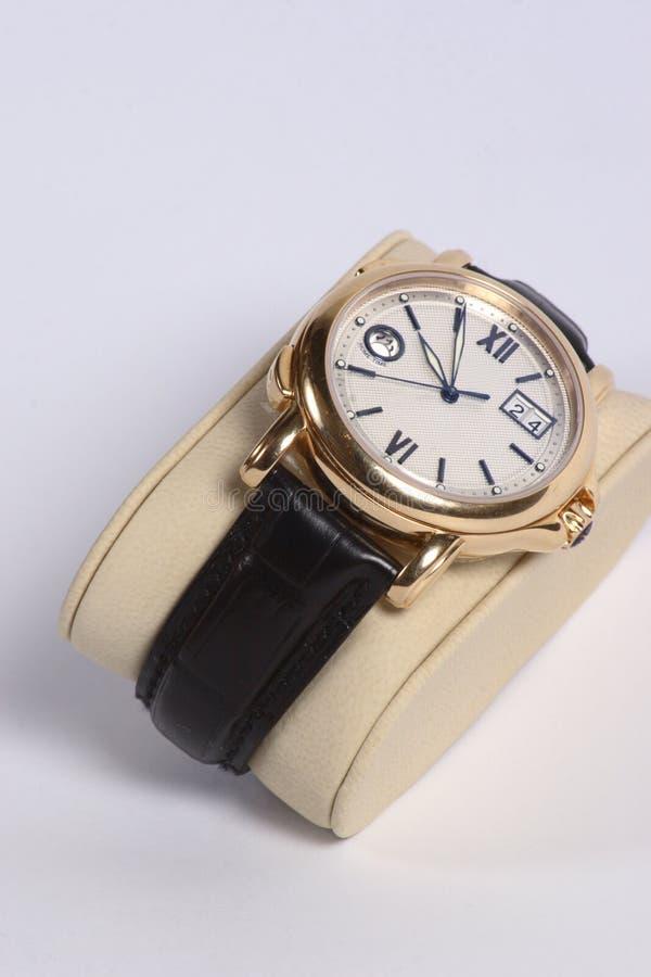 χρυσό ρολόι ατόμων s στοκ εικόνα