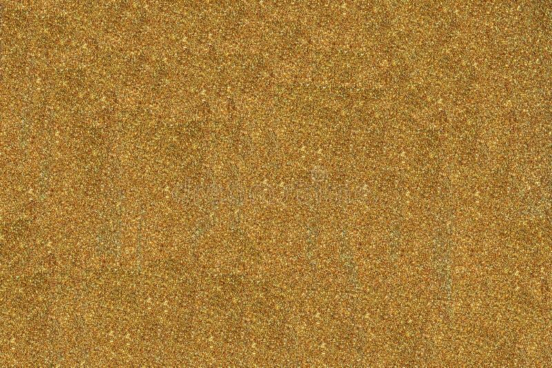 Χρυσό σκόνης λεπίδων εννοιολογικό σχεδίων υπόβαθρο σύστασης επιφάνειας αφηρημένο στοκ φωτογραφίες